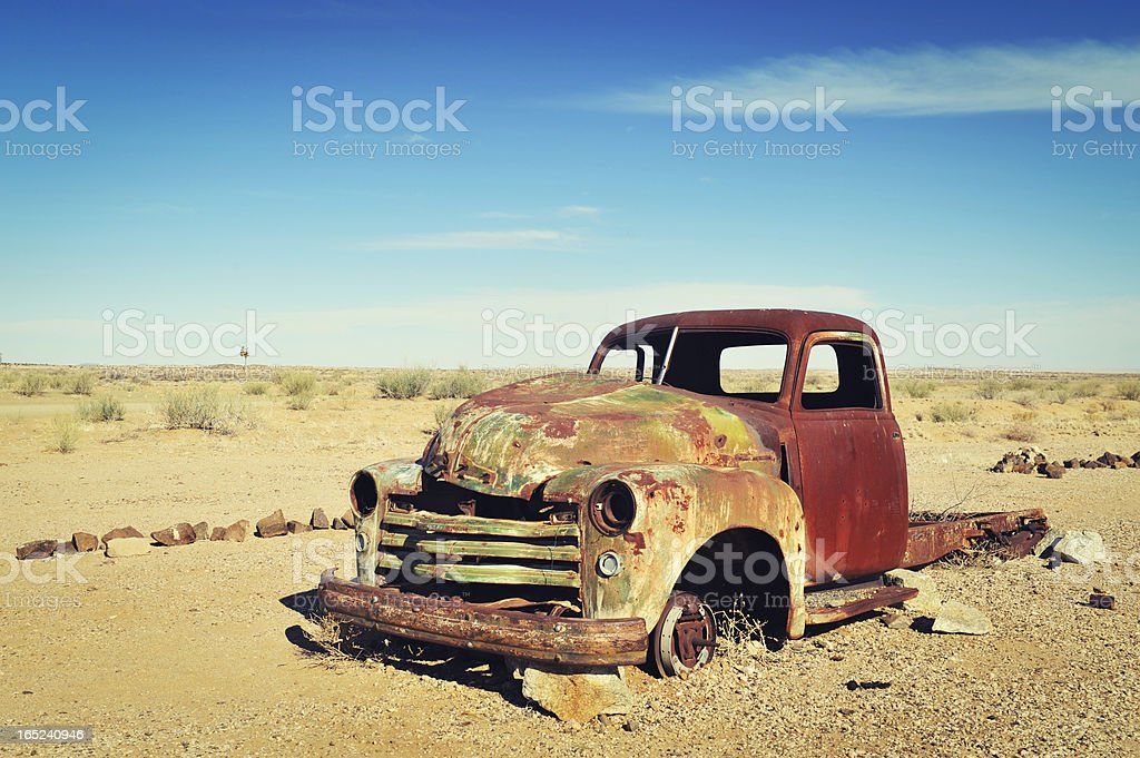 Rusty old wreck abandoned in the Namibia Desert royalty-free stock photo