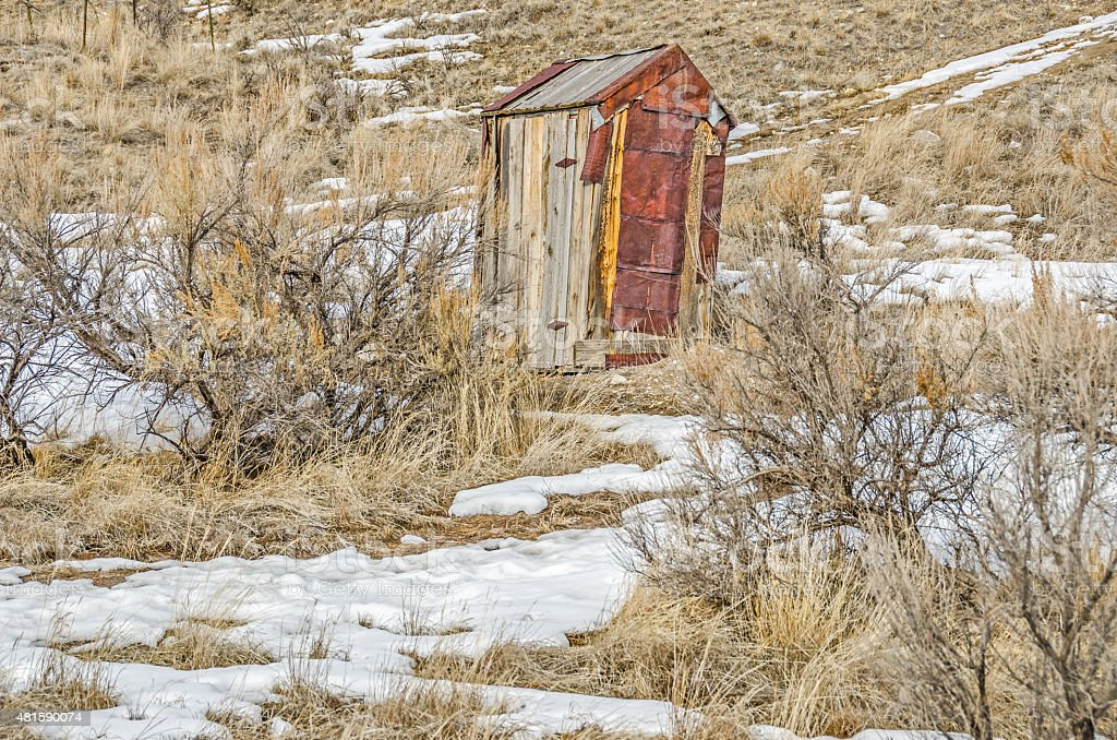 Rusty Outhouse stock photo