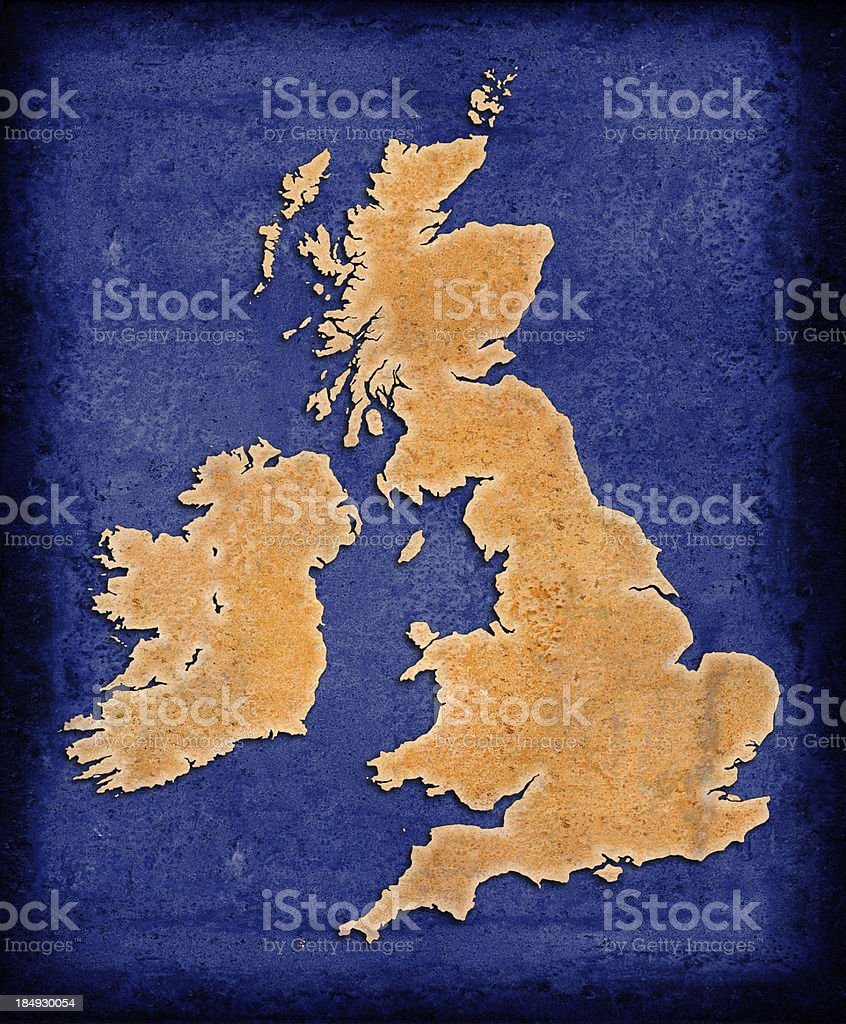 Rusty outline of the UK on blue grunge background royalty-free stock photo
