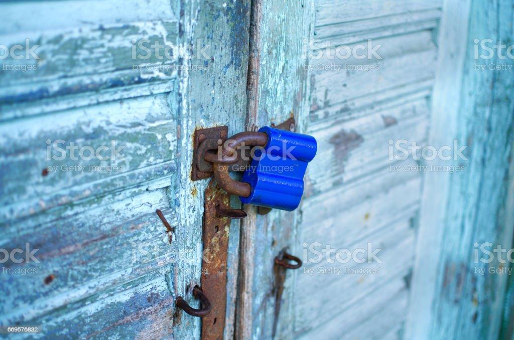 Rusty padlock on wooden garden shed door stock photo