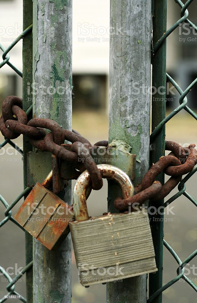 rusty padlocks and old chain closed gate royalty-free stock photo
