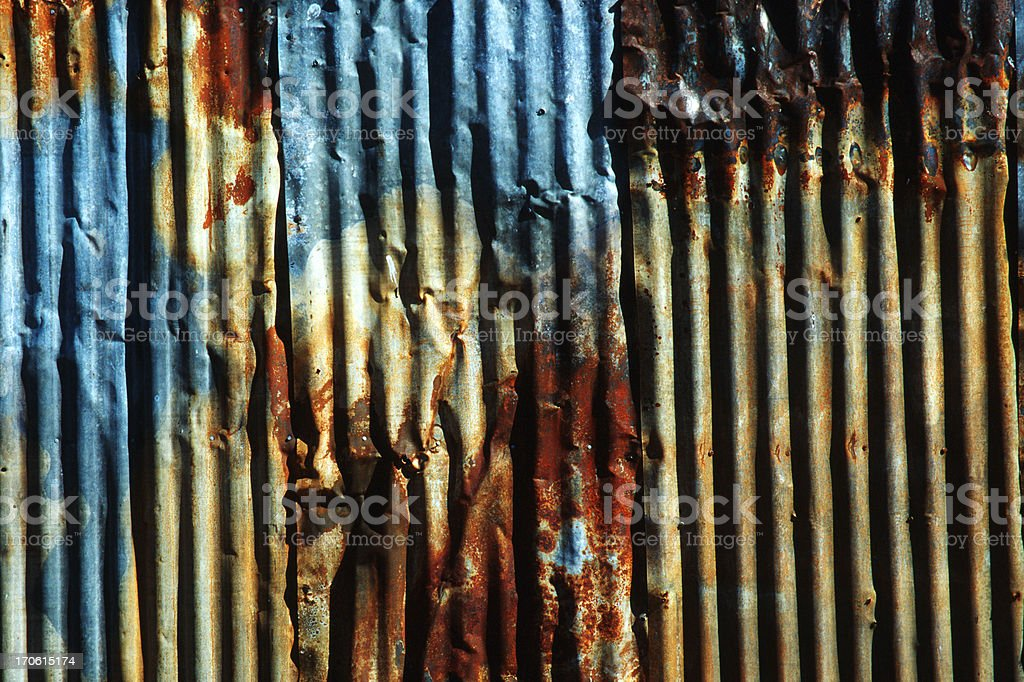 Rusty Painted Corrugated Metal, grunge pattern, irregular background royalty-free stock photo