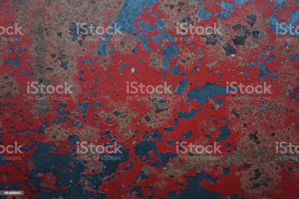 Rusty patterns on iron with red paint stock photo