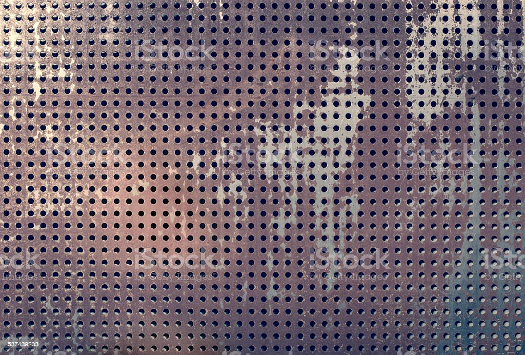 Rusty perforated plate texture stock photo
