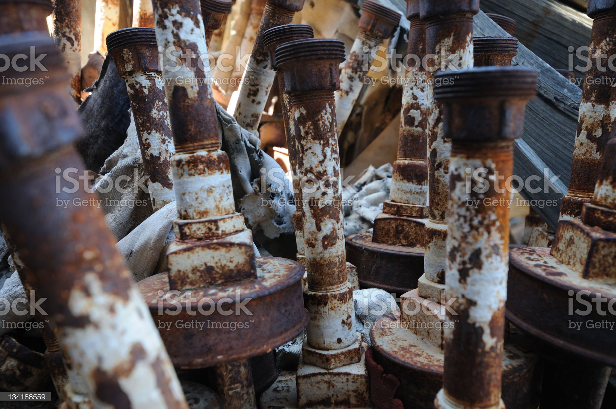 rusty pipes in a barrel royalty-free stock photo