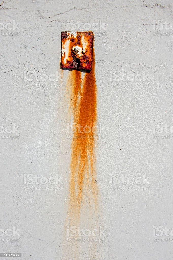 Rusty plate on wall. stock photo