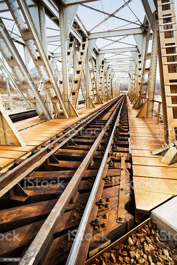 Rusty railroad bridge stock photo