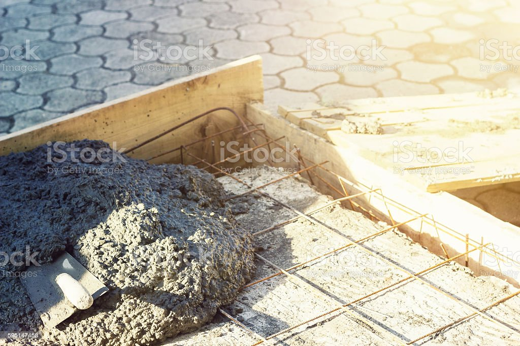 rusty rebar grids with spatula in a concrete floor stock photo