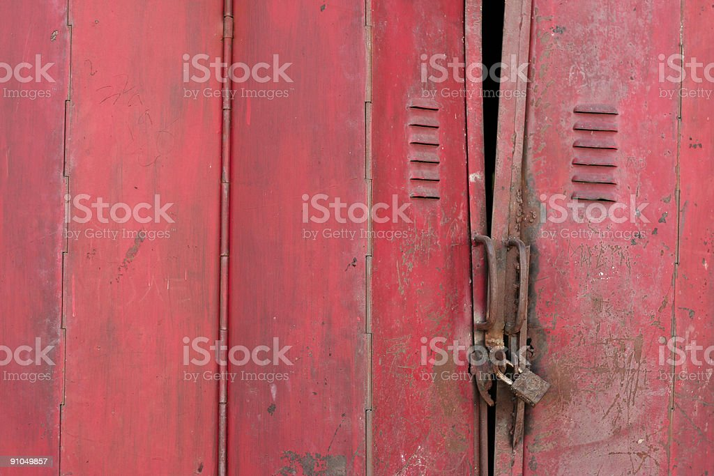 rusty red metal folding door royalty-free stock photo