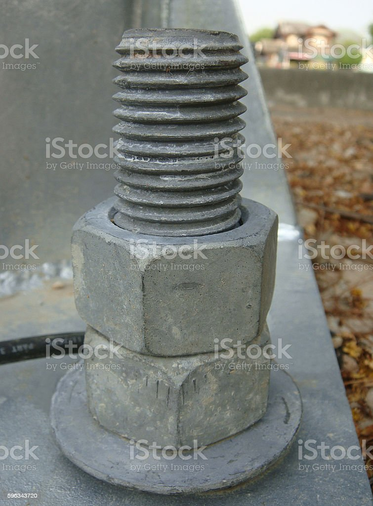 Rusty screw and nut stock photo