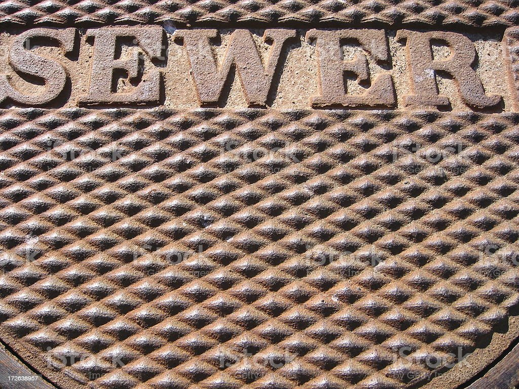 Rusty Sewer Lid royalty-free stock photo