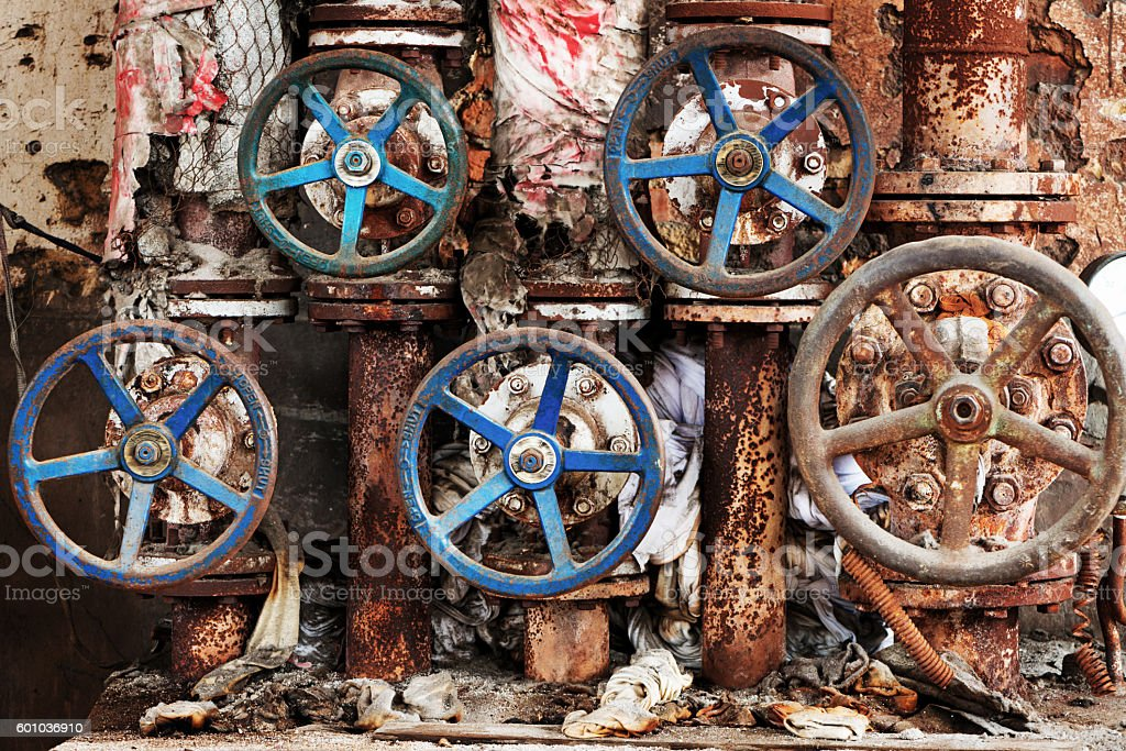 Rusty sewer valve - underground old sewage treatment plant stock photo