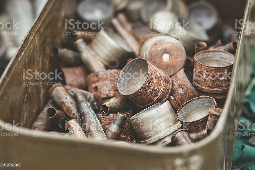 rusty shell casings from assault rifles and mounted grenade launchers stock photo