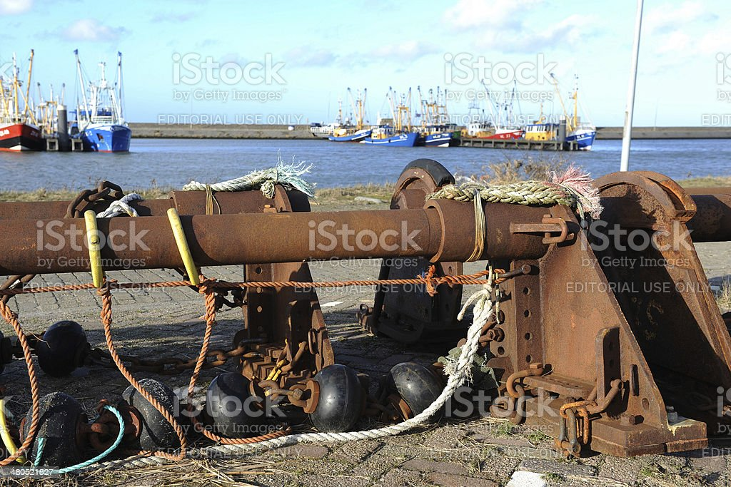 Rusty ship parts on the quay of a harbour stock photo