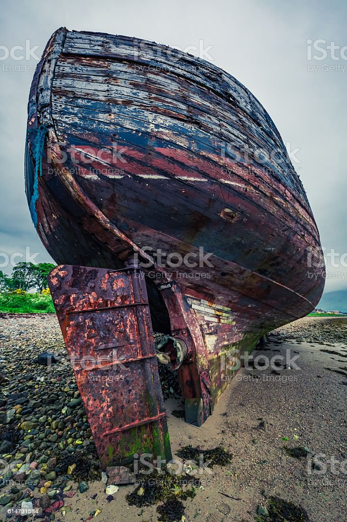 Rusty shipwreck on shore in Fort William, Scotland stock photo