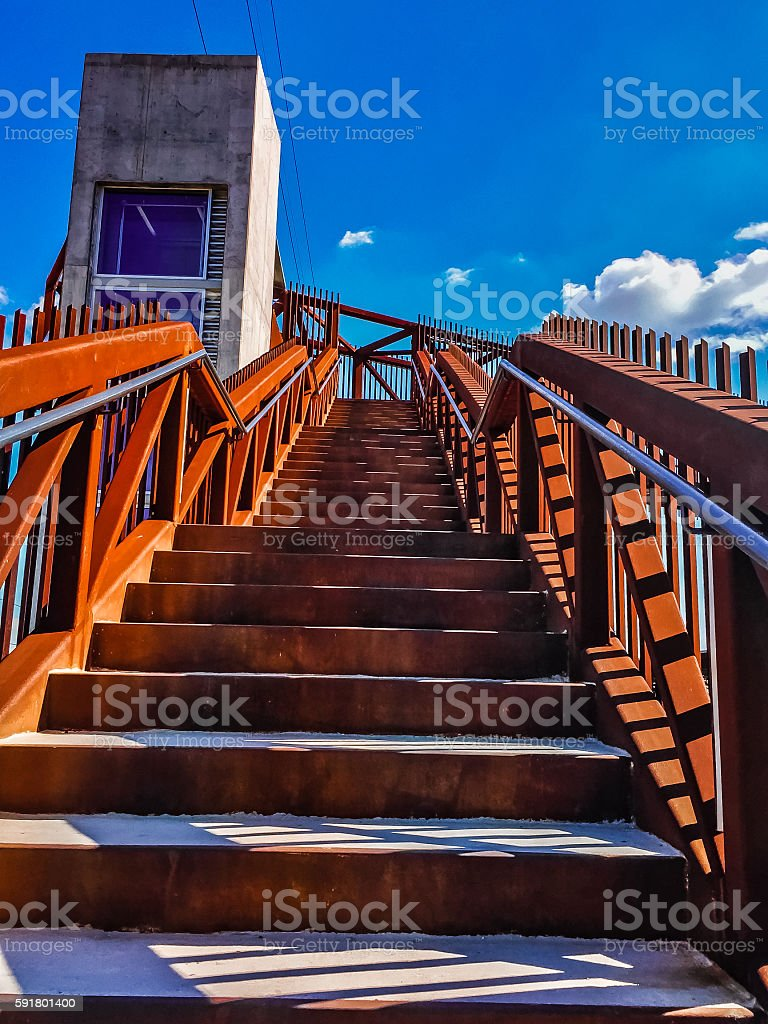 rusty stairs and blue sky stock photo