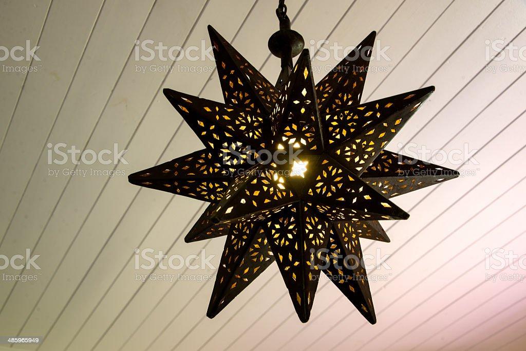 Rusty star shaped lamp royalty-free stock photo