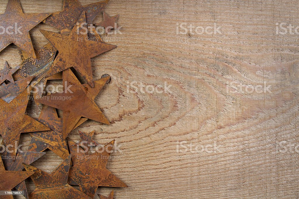 Rusty stars on a wooden background stock photo