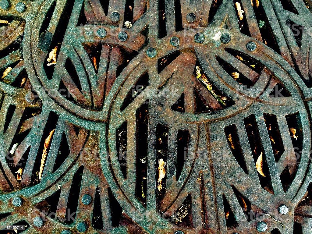 Rusty Steel Grating on city sidewalk royalty-free stock photo