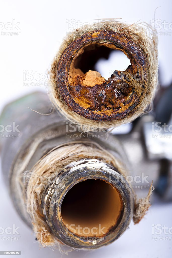 2 rusty steel pipes lay on top of each other stock photo