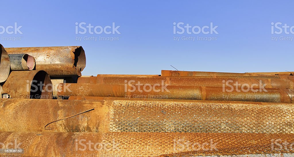 Rusty steel-pipes against blue sky royalty-free stock photo