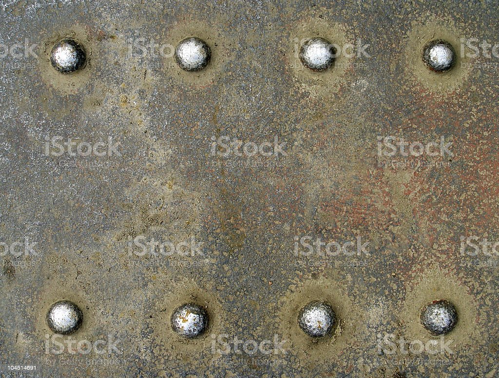 Rusty tap background with eight rivets royalty-free stock photo