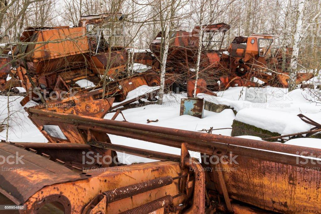 Rusty Threshers in Snow Chernobyl stock photo