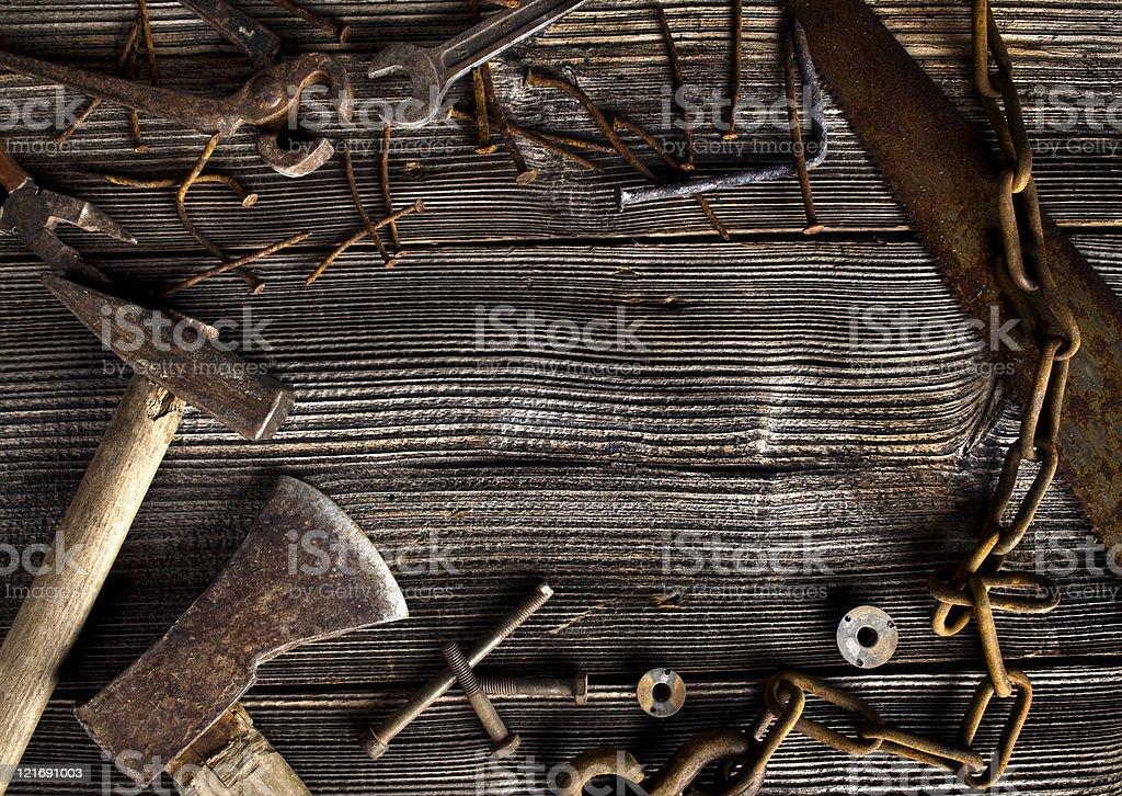 Rusty tools on old dark plank royalty-free stock photo