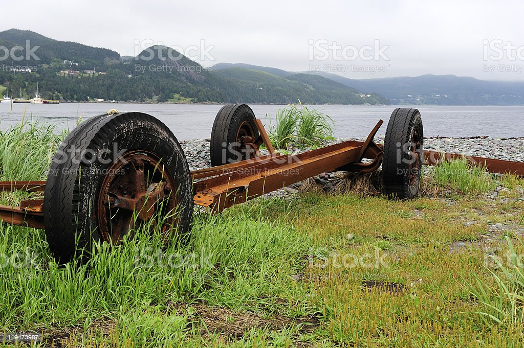 Rusty wheels at Placentia Bay stock photo