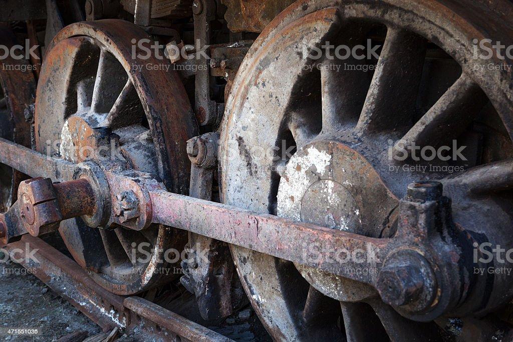 rusty wheels of old steam locomotive stock photo