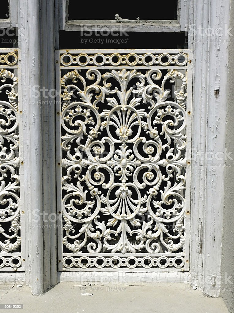 rusty white wrought iron covered window royalty-free stock photo