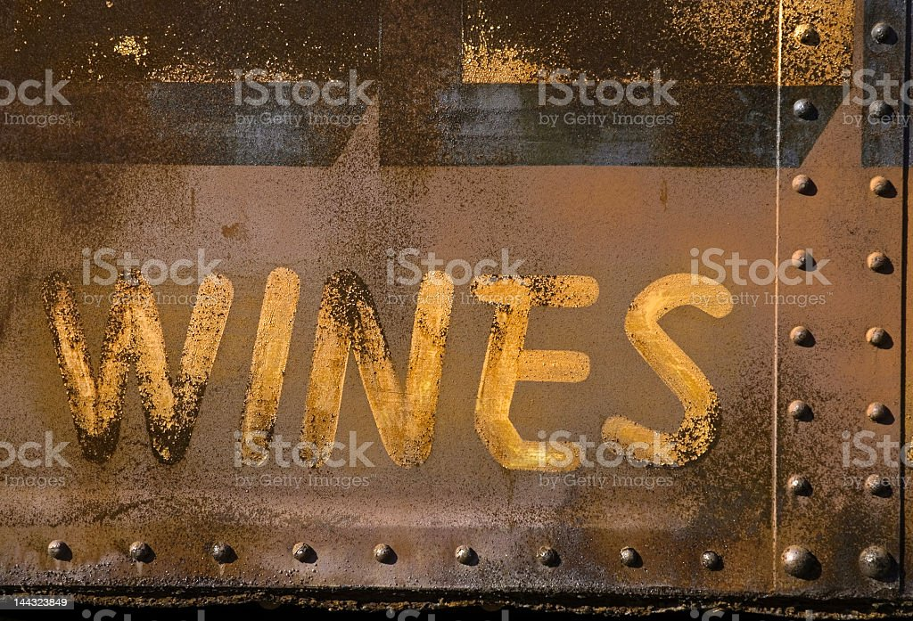 Rusty Wine Sign on the Side of a Caboose stock photo