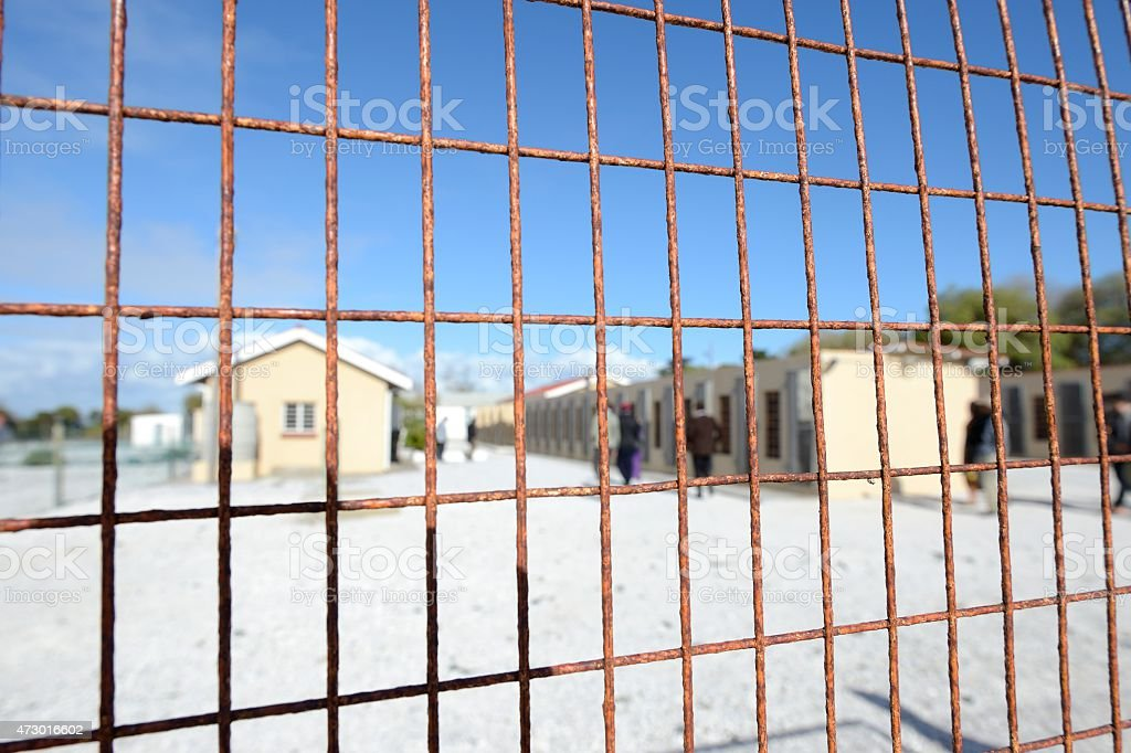 Rusty wire fencing around prison compound on Robben Island stock photo