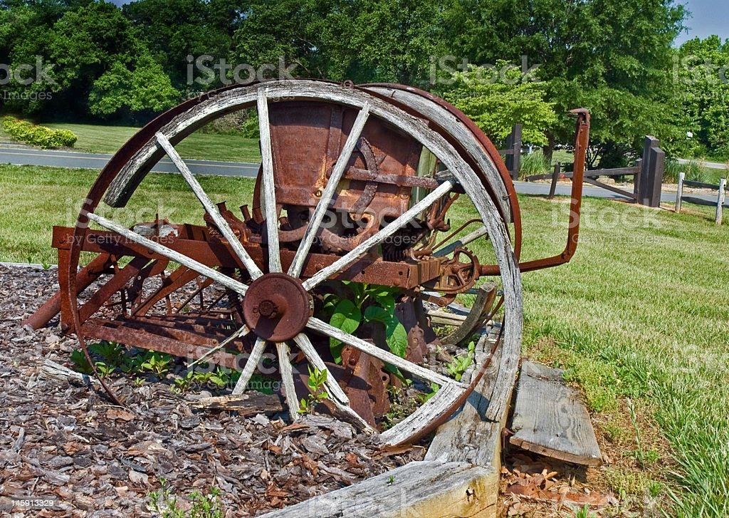 Rusty Wooden Wheel on old Farm Equipment royalty-free stock photo