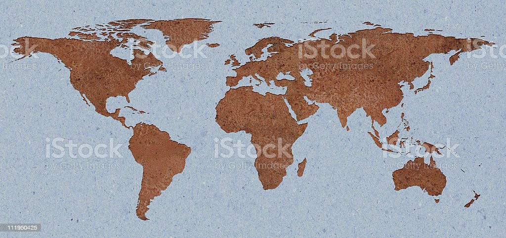 Rusty world map inset into blue paper royalty-free stock photo