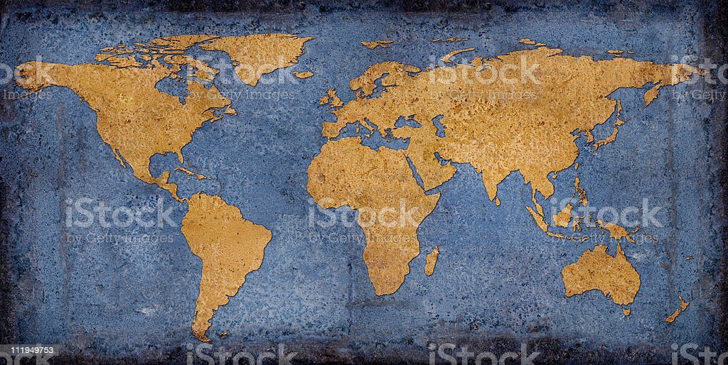 Rusty world map on blue toned background royalty-free stock photo