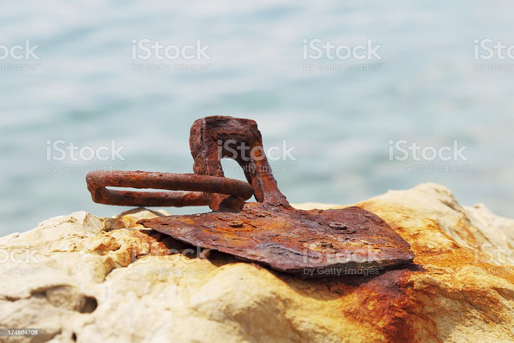 rusty worn out ship dock metal ring in rock stock photo