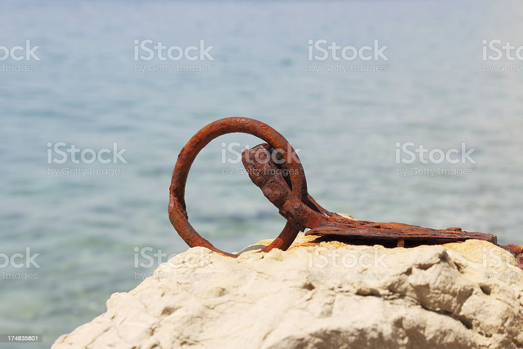 rusty worn out ship dock metal ring royalty-free stock photo