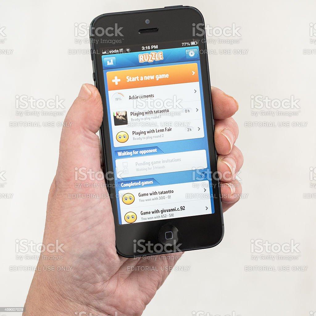 Ruzzle app on Iphone 5 stock photo
