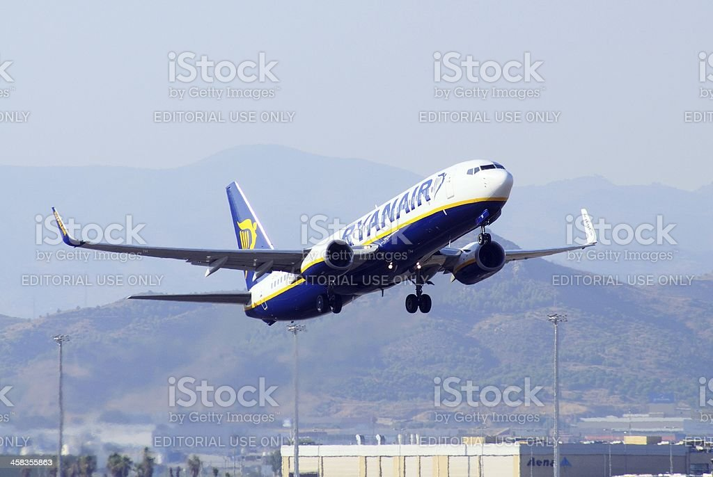 Ryanair 737 taking off, Malaga, Spain. stock photo
