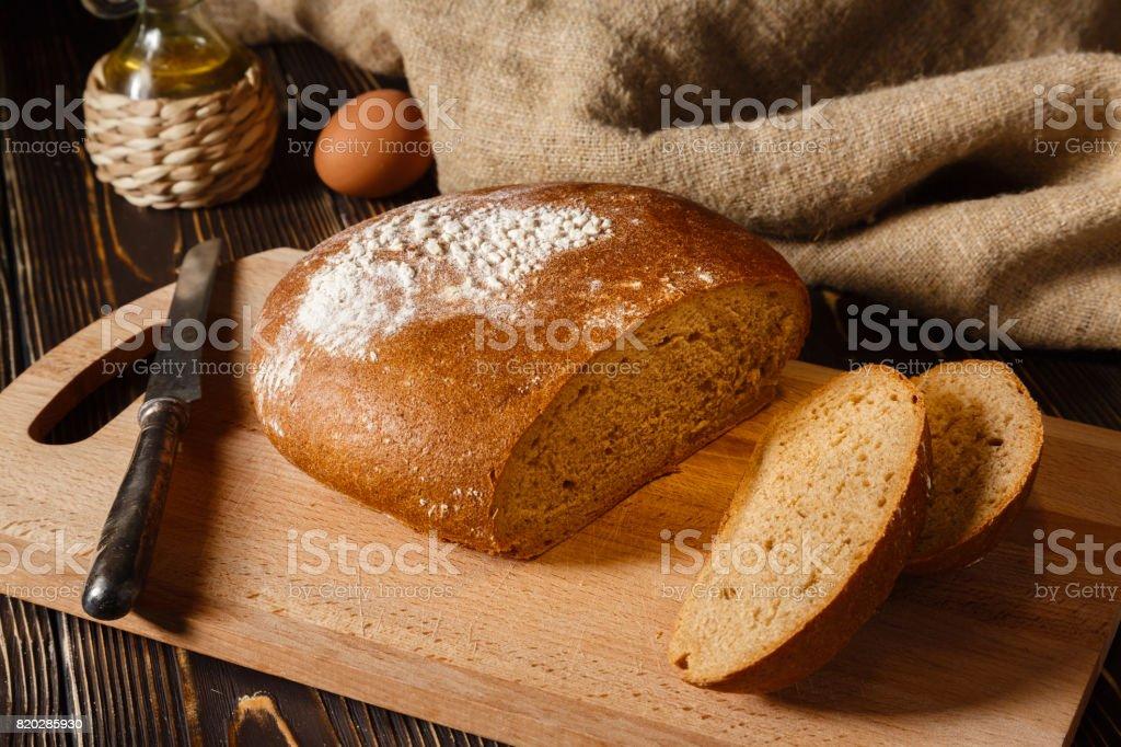 Rye bread lies on a breadboard stock photo
