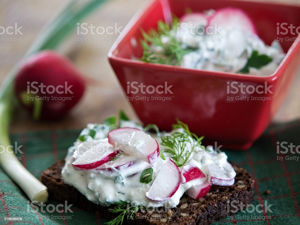 Rye bread with cottage cheese, radishes and herbs royalty-free stock photo
