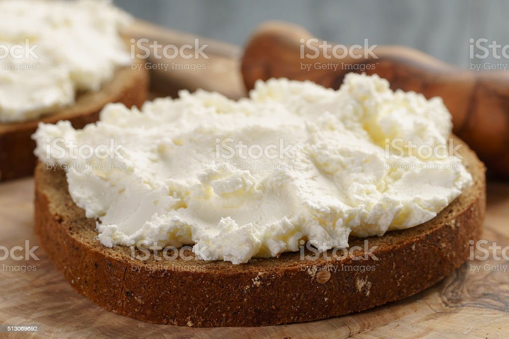 rye bread with cream cheese on wood table stock photo