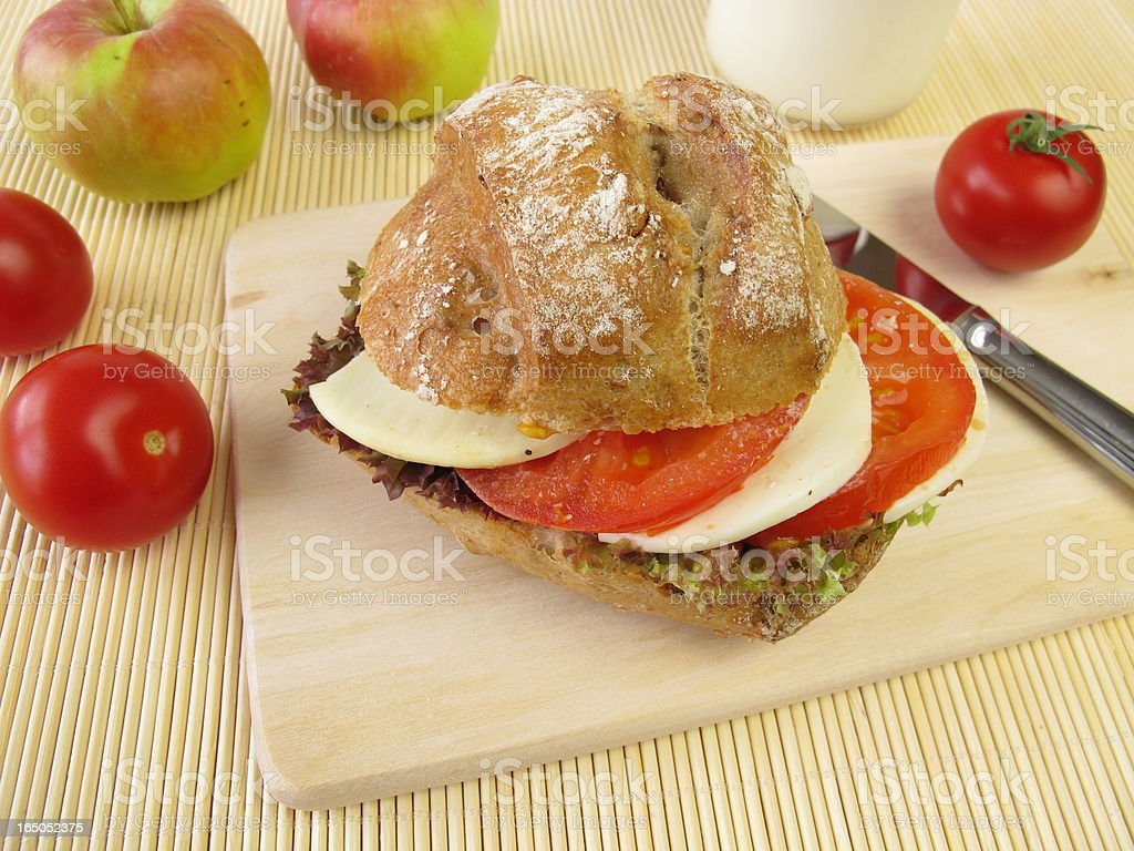 Rye roll with tomato and mozzarella for taking along stock photo