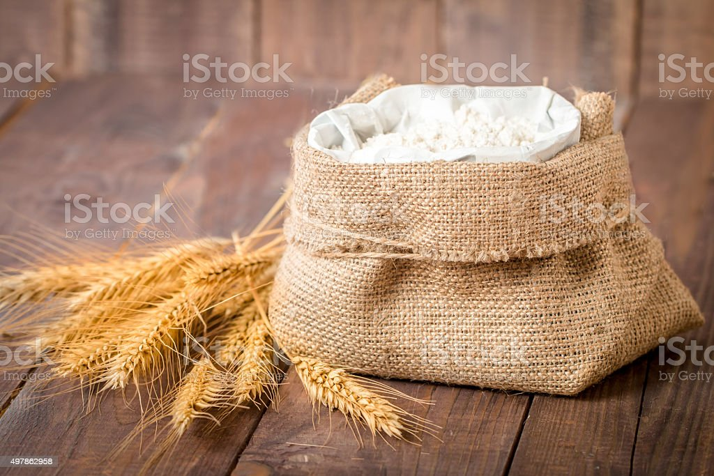Rye spikes and flour stock photo