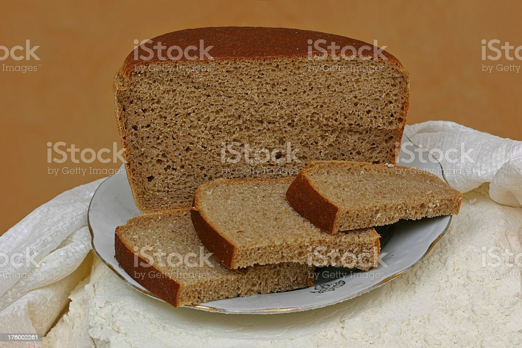 Rye-bread and flour royalty-free stock photo
