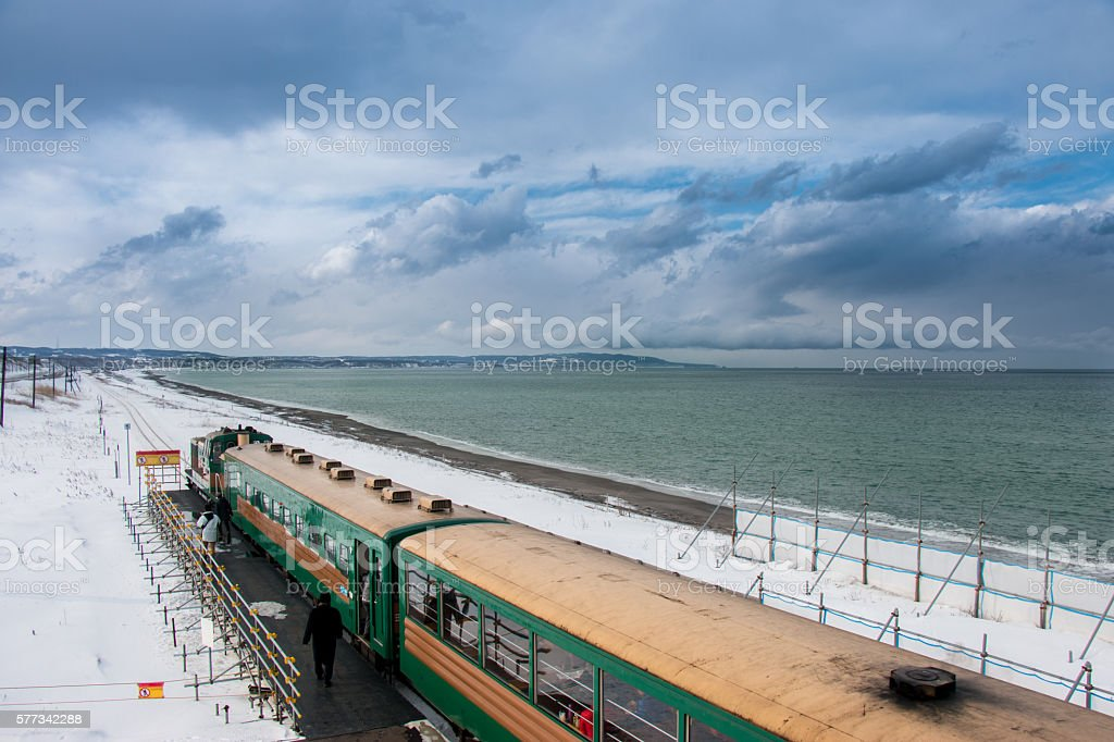 ryuho norokko train stop at station along beach stock photo