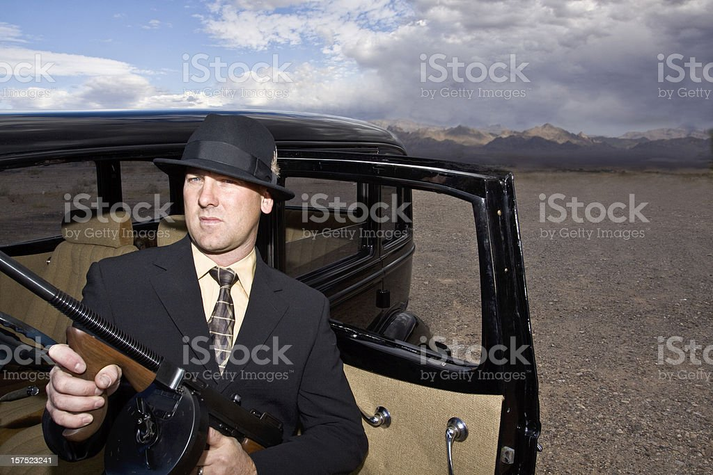 1920's and 1930's Gangster with Tommy Gun. stock photo