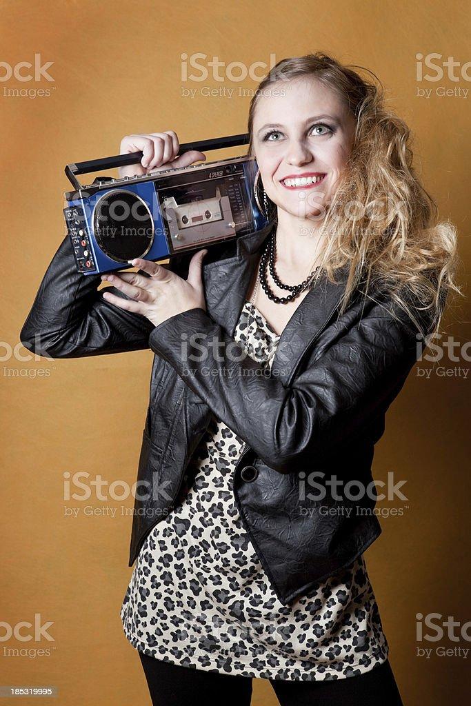 80's Girl Listening to Cassette Boombox stock photo