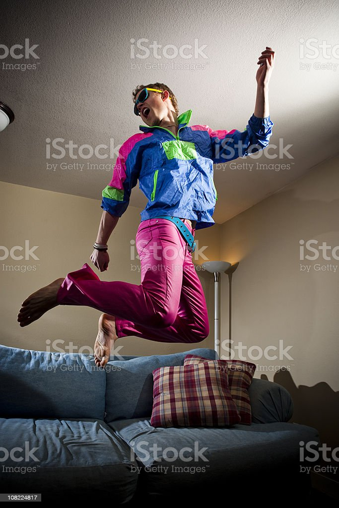 80's guy jumping off his couch royalty-free stock photo